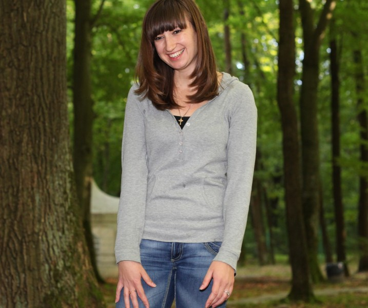 an appealing smiling Catholic girl in a park, picture 9