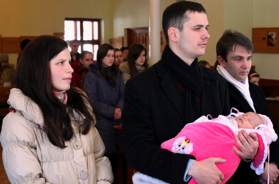 baptism of a baby girl in a Catholic church, picture 4