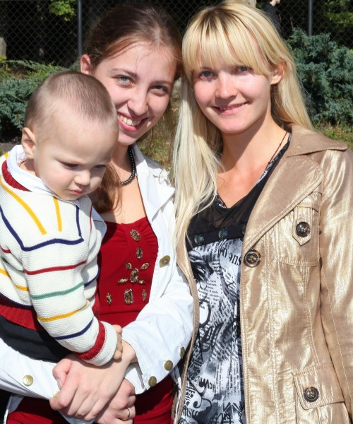 two beautiful young charming Catholic women and a baby boy, photo 2