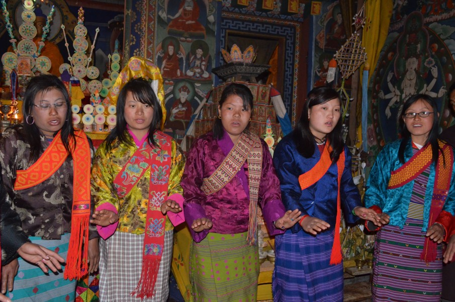 Bhutanese women dancing in temple
