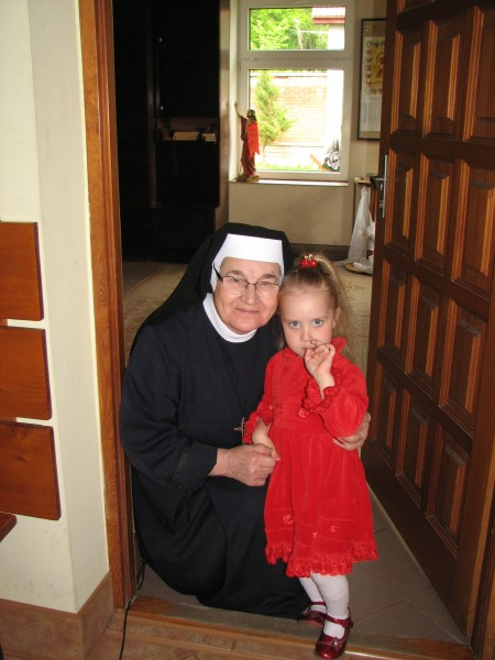 A Catholic nun with a Catholic child girl