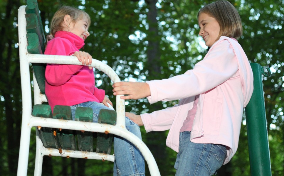 two cute Catholic child girls in a park, photo 36