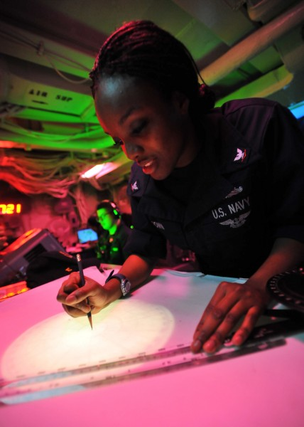 Defense.gov News Photo 110308-N-0569K-048 - Petty Officer 3rd Class Lakysha Brown uses the dead reckoning tracer to plot the ship s course and speed in the commanding officer s tactical plot