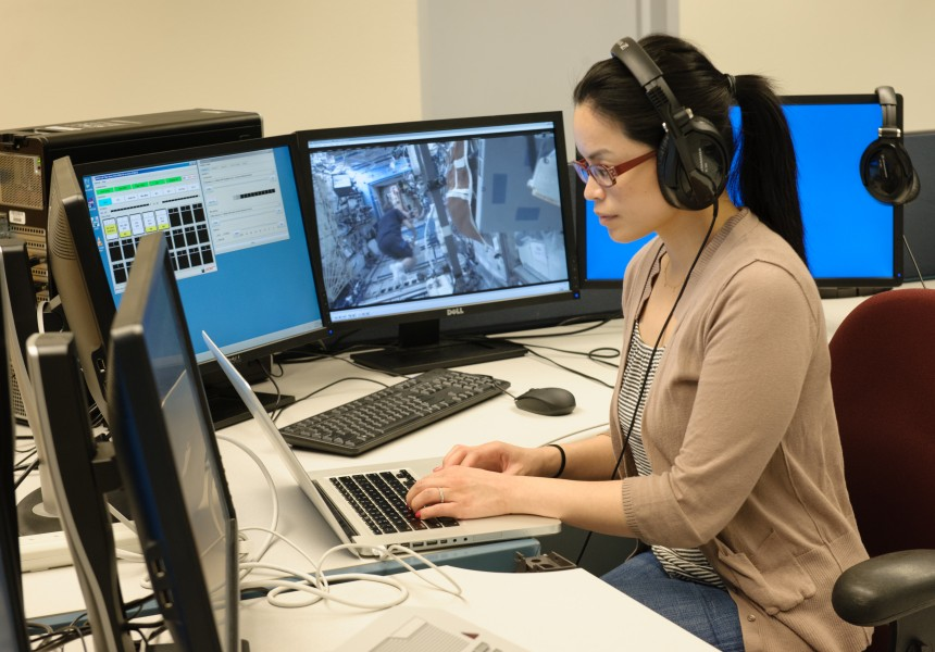 Estrellina Pacis on console as science lead in the Multi-Mission Operations Center