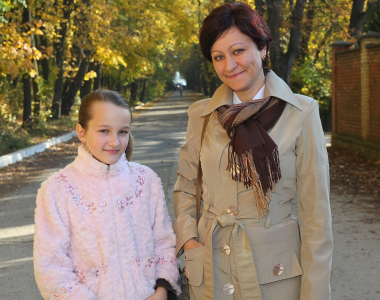 an exceptionally beautiful Catholic girl with her mother, picture 34