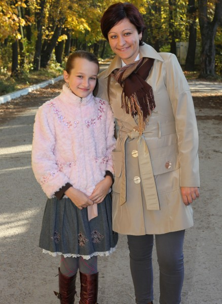 an exceptionally beautiful charming Catholic girl with her mother, picture 35