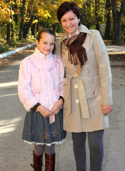 an exceptionally beautiful charming Catholic girl with her mother, picture 37