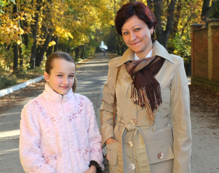 an exceptionally beautiful Catholic girl with her mother, picture 233