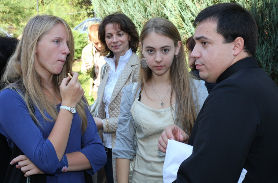 girls and a priest near a Catholic Church after the Holy Mass, photo 2
