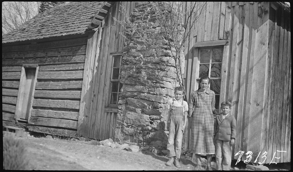 Hogshed, P.C., wife and children in front of home - NARA - 280789