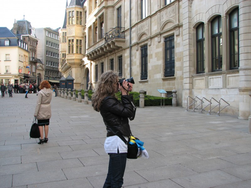 A girl taking a photo with a Canon DSLR