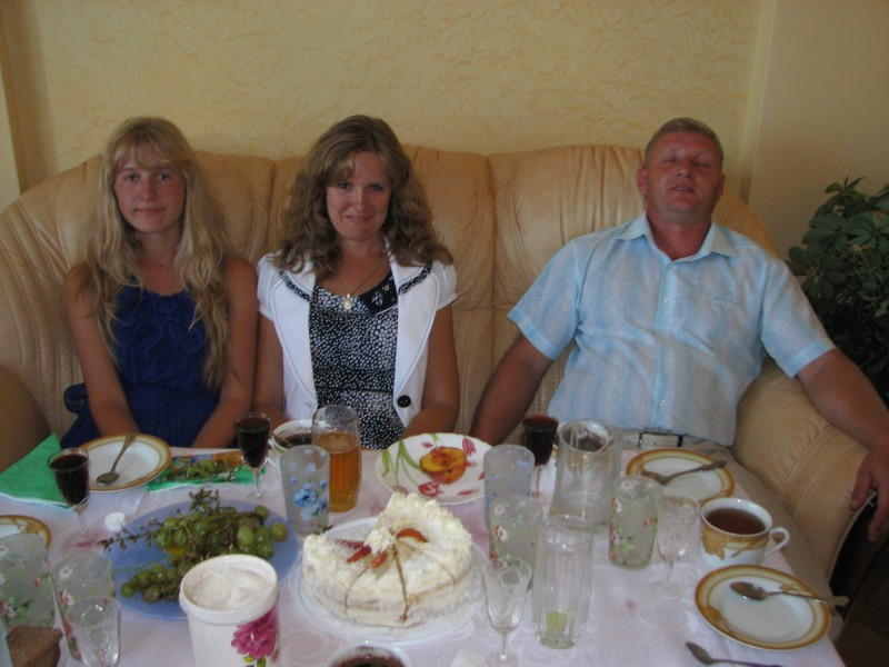 Daughter, mother and father - visiting their friends in their apartment in Lviv, Ukraine, Europe, summer 2011, picture 4