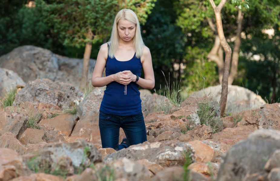 a girl praying in Medjugorje, Bosnia, July 2014, picture 9