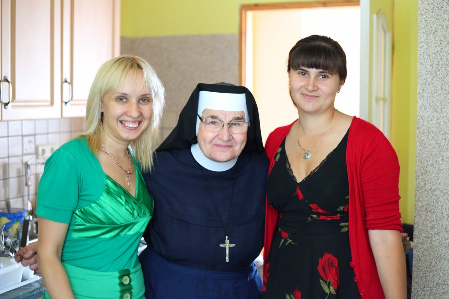 A nun with two young Catholic women