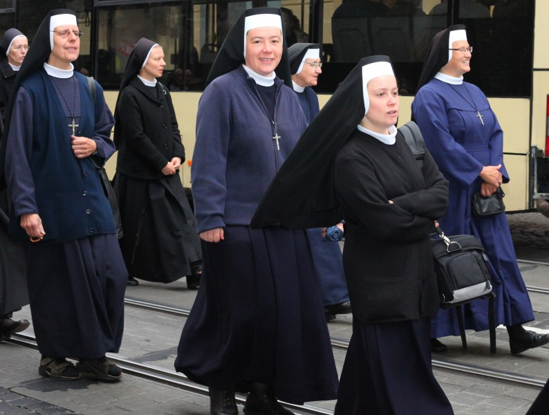 Catholic nuns on a procession during a celebration