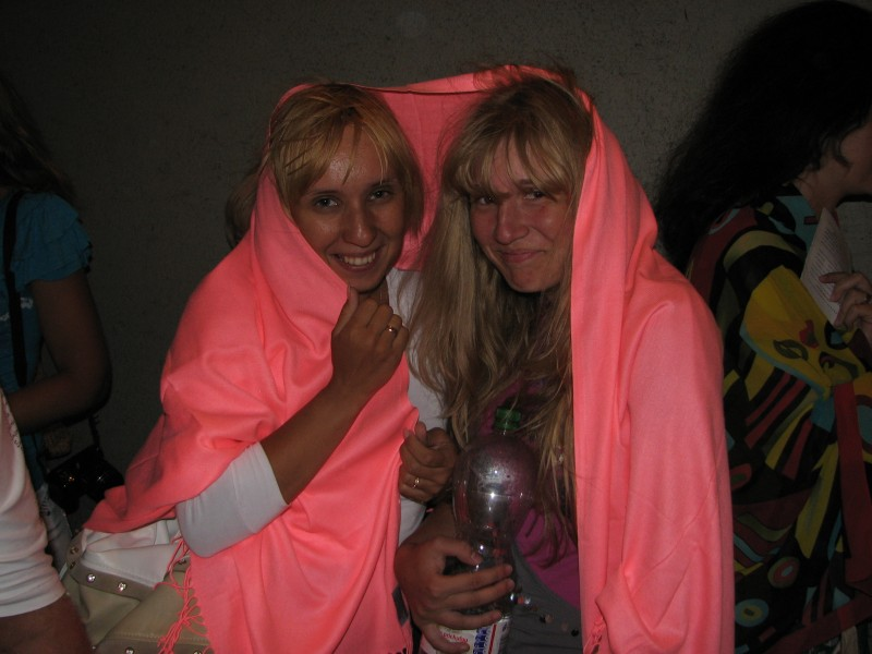 A young woman and a girl hiding from rain in Prague (Praha) city, Czech Republic, European Union, picture 36