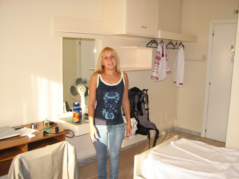 A young woman in a hotel room in Rome, Italy, European Union, August 2011, picture 1.