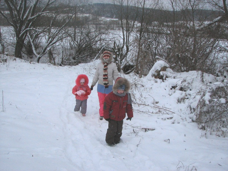 Mother with kids walking on the snow