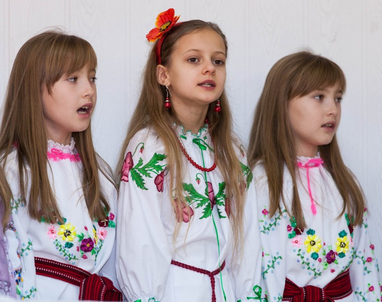 three young schoolgirls performing in December 2013
