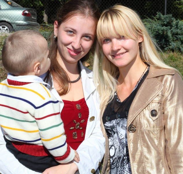 two beautiful young charming Catholic women and a baby boy, photo 5