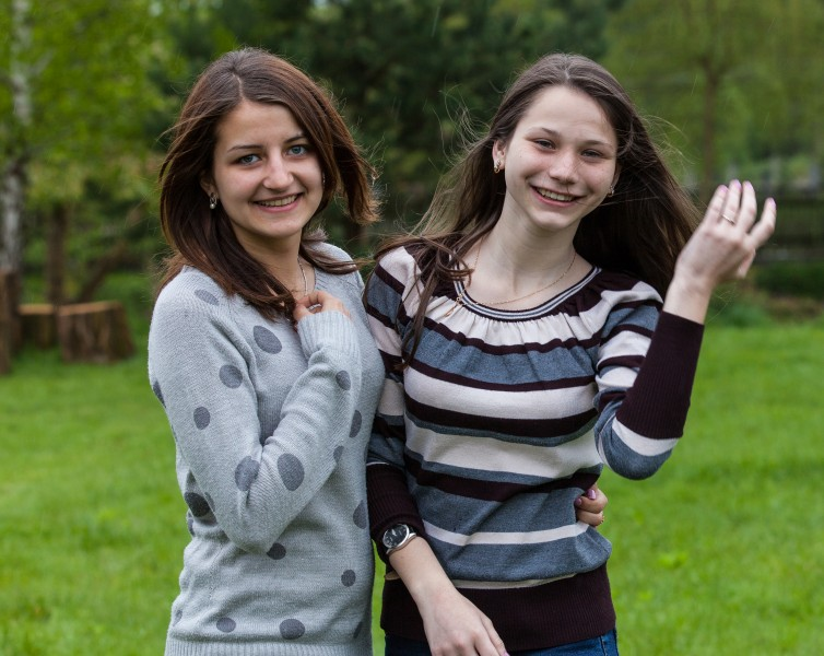 two charming brunette girls photographed in a Catholic recollection and recreation center in May 2014, picture 2/6