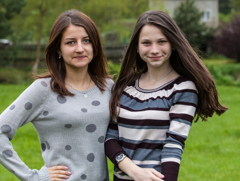 two charming brunette girls photographed in a Catholic recollection and recreation center in May 2014, picture 6/6