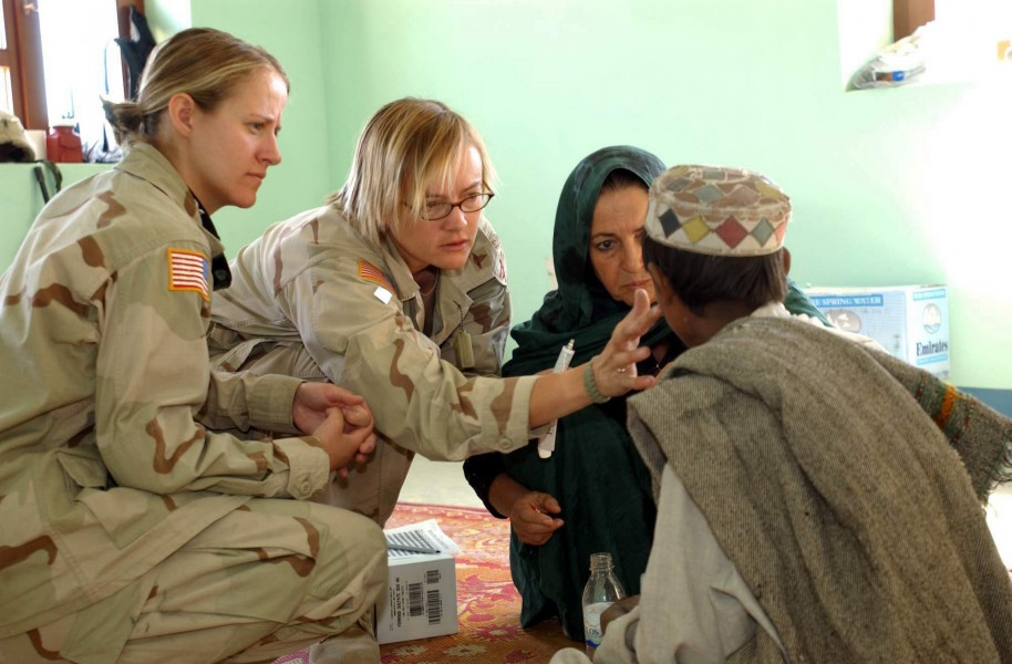 US female specialists treating a young Afghan nomad boy
