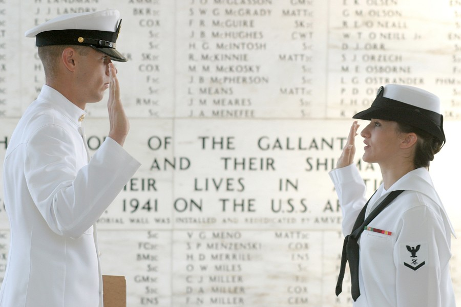 US Navy 030828-N-3228G-001 Journalist 3rd Class Sunday Williams of Navy Region Hawaii Public Affairs, reenlists in the shrine room on board the USS Arizona Memorial by her leading chief petty officer