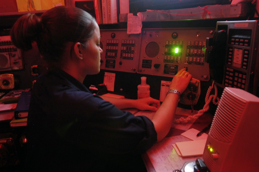 US Navy 040723-N-4565G-002 Aviation Ordnanceman 3rd Class Sara Krueger of Rhintoants, Wis., uses the 46MC to call up the magazine room, during a vertical replenishment with fast combat support ship USS Seattle (AOE 3)