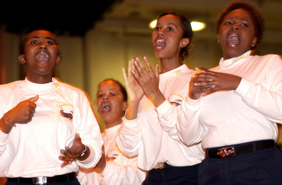 US Navy 060630-N-7130B-103 In the hangar bay of USS Ronald Reagan (CVN 76), members of the ship^rsquo,s gospel choir, The Storm, perform for the crew