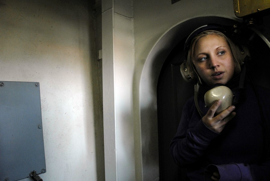 US Navy 071105-N-4776G-279 Aviation Boatswain's Mate (Fuel) Airman Amber Punkwitz uses a sound powered telephone during a refueling at sea aboard Nimitz-class aircraft carrier USS Ronald Reagan (CVN 76)