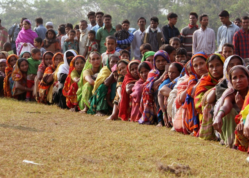 US Navy 071129-M-3095K-009 People gather on a field at Rangabali College in southern Bangladesh to receive medical attention from a U.S. Navy medical team in the wake of Tropical Cyclone Sidr