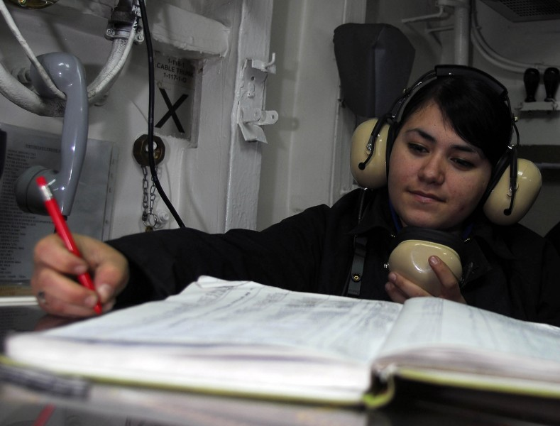 US Navy 081024-N-2717A-021 Aviation Boatswain's Mate (Handling) Airman Sarah Martinez logs the position of aircraft in hangar deck control