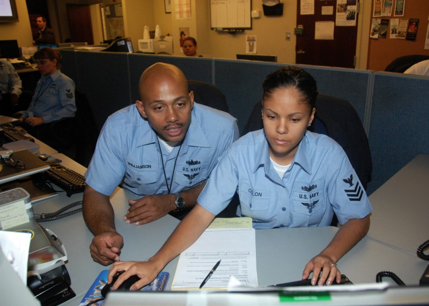 US Navy 081205-N-2147L-002 Information Technician 1st Class Larry Williamson assists Information Technician Taysha Colon at Naval Network Warfare Command