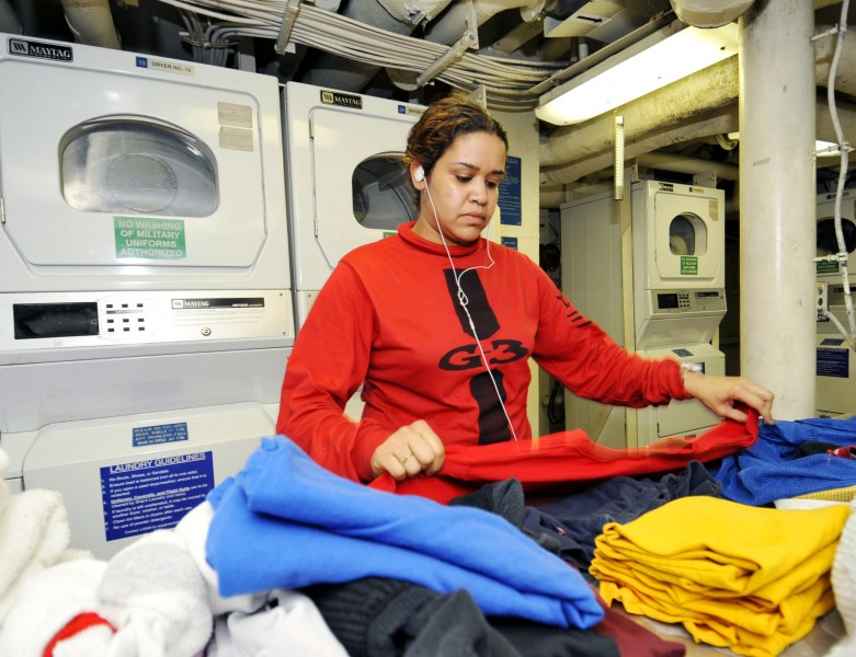 US Navy 100628-N-6003P-021 Aviation Ordnanceman 1st Class Dalia Ignacio folds her laundry aboard the aircraft carrier USS Harry S. Truman (CVN 75) during a break in her schedule