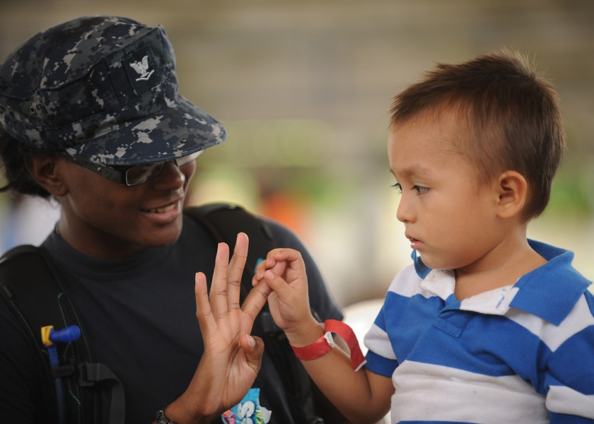 US Navy 110715-N-NY820-340 Hospital Corpsman 3rd Class Chavone Taylor plays with a pediatrics patient during a Continuing Promise 2011 community se