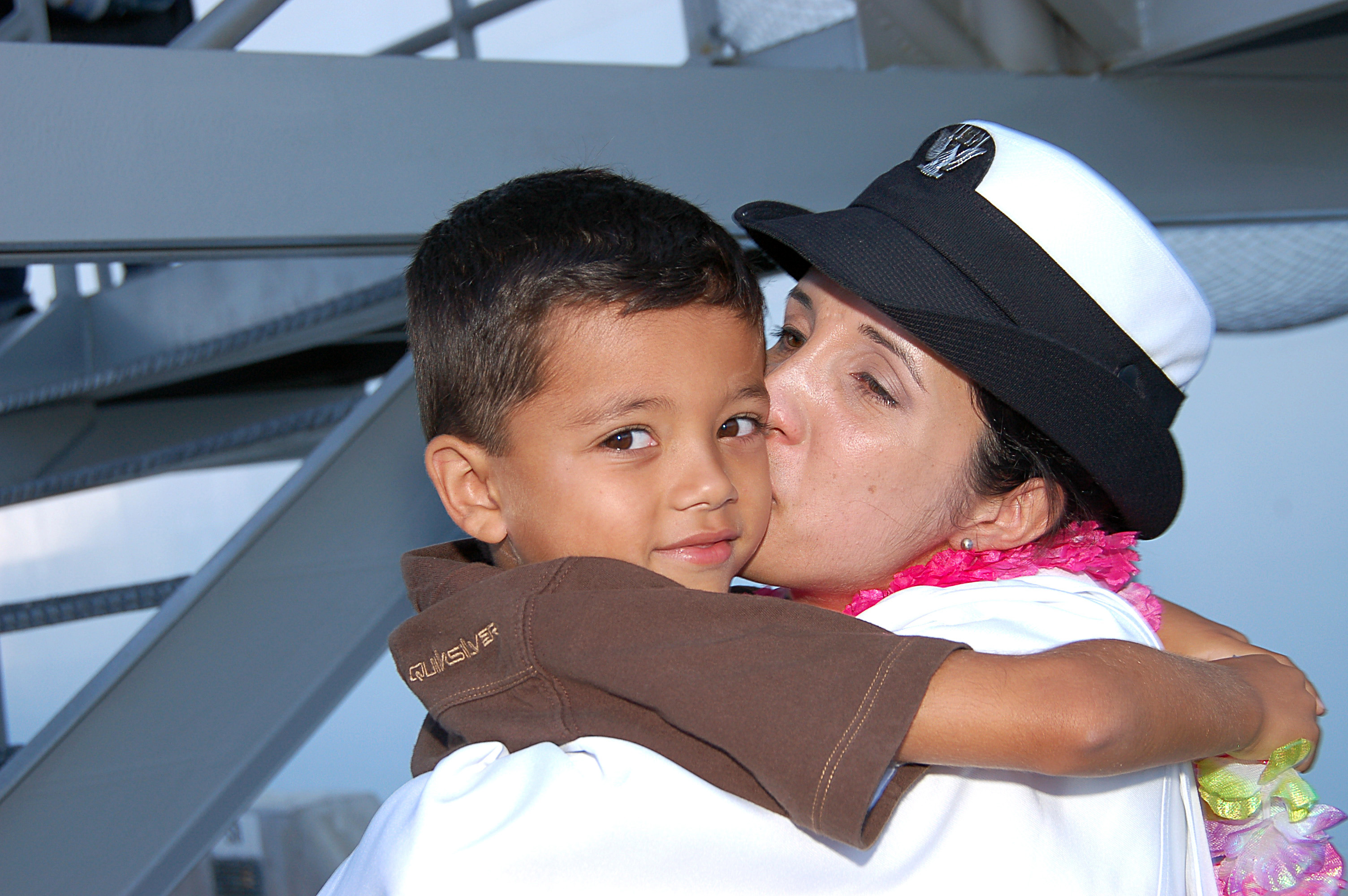 US Navy 080925-N-3570S-116 Hospital Corpsman 2nd Class Maria Collins-Alcala kisses her six-year old son