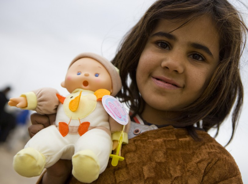 Happy Afghan girl after been given a doll