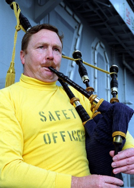US Navy 021024-N-5555F-004 Cmdr. Jeffrey Wolf plays the bagpipes