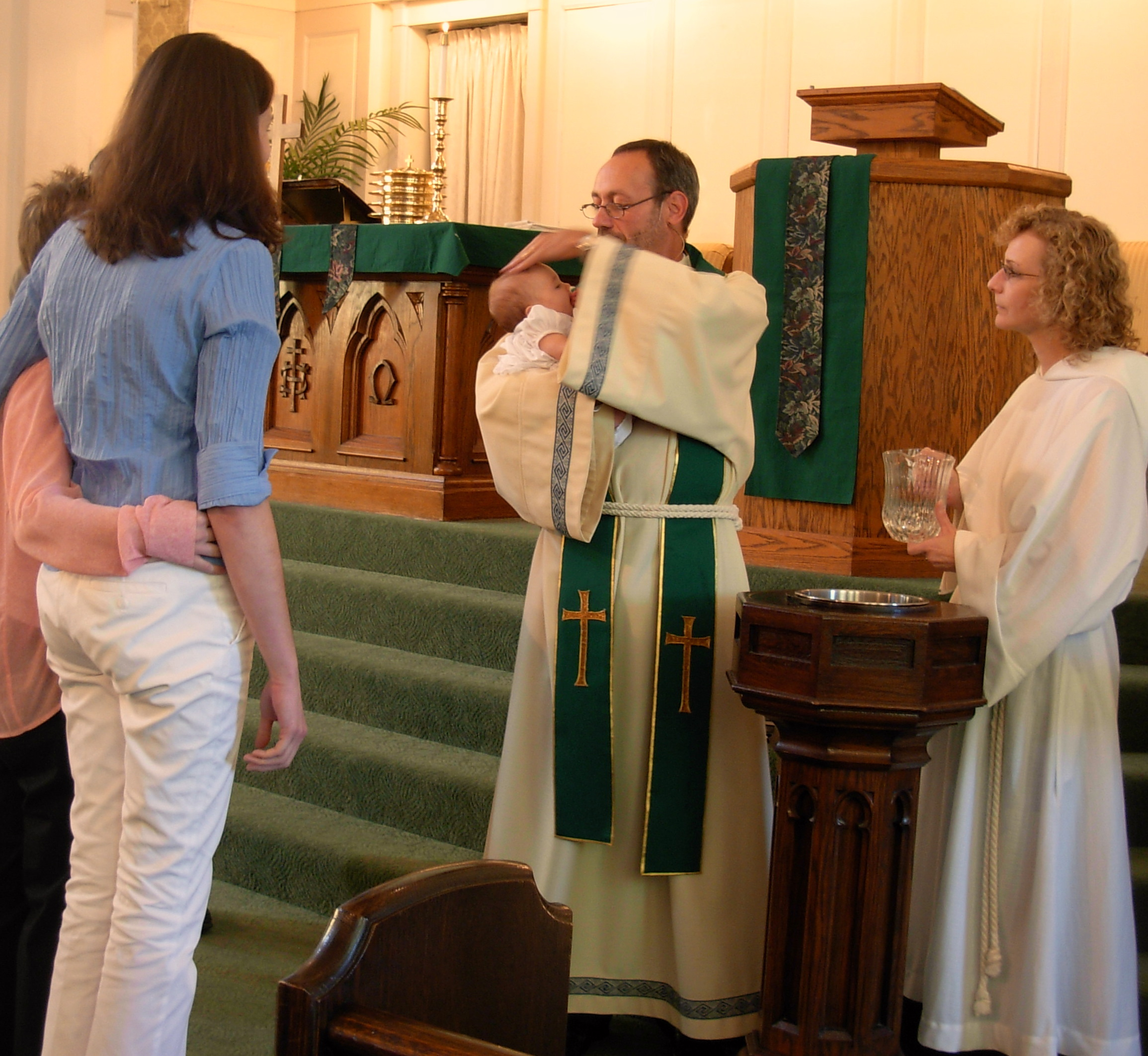 Infant baptism in the Metropolitan Community Church.