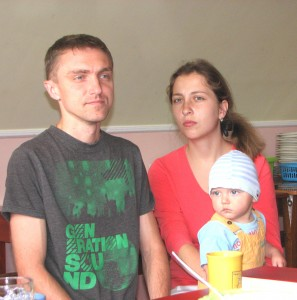 A married couple with kid: a young Catholic family, picture 2