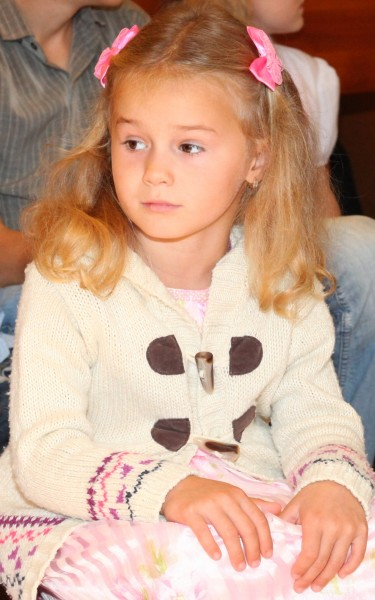 a beautiful young girl in a Catholic Church
