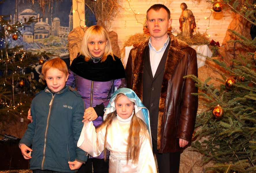 a Catholic family in a Church during the Christmas time, photo 2
