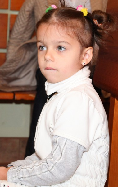a child girl in a Catholic Church