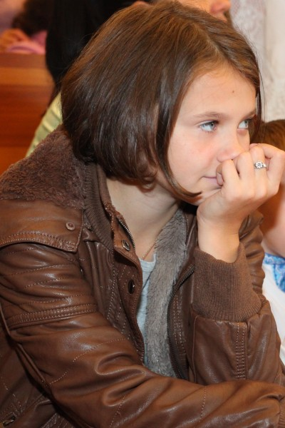 a child girl in a Catholic Church, photo 2