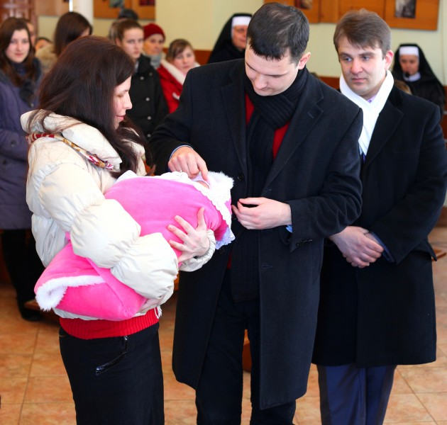 baptism of a baby girl in a Catholic church, picture 1