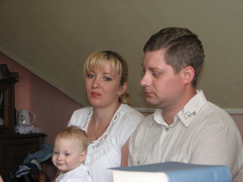 A young family at a meeting of Catholic married couples