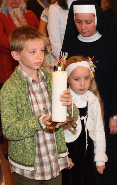 Catholic children at a Holy Mass