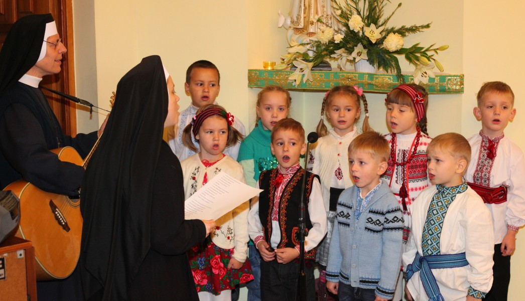 children singing with nuns in a Catholic kindergarten