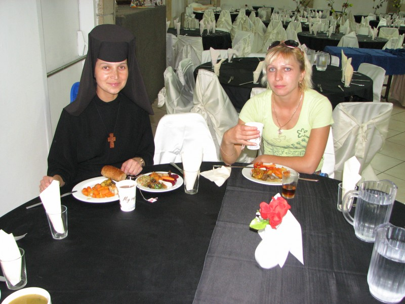 A Catholic nun and a girl in a hotel's restaurant in Israel - catholic pilgrims.
